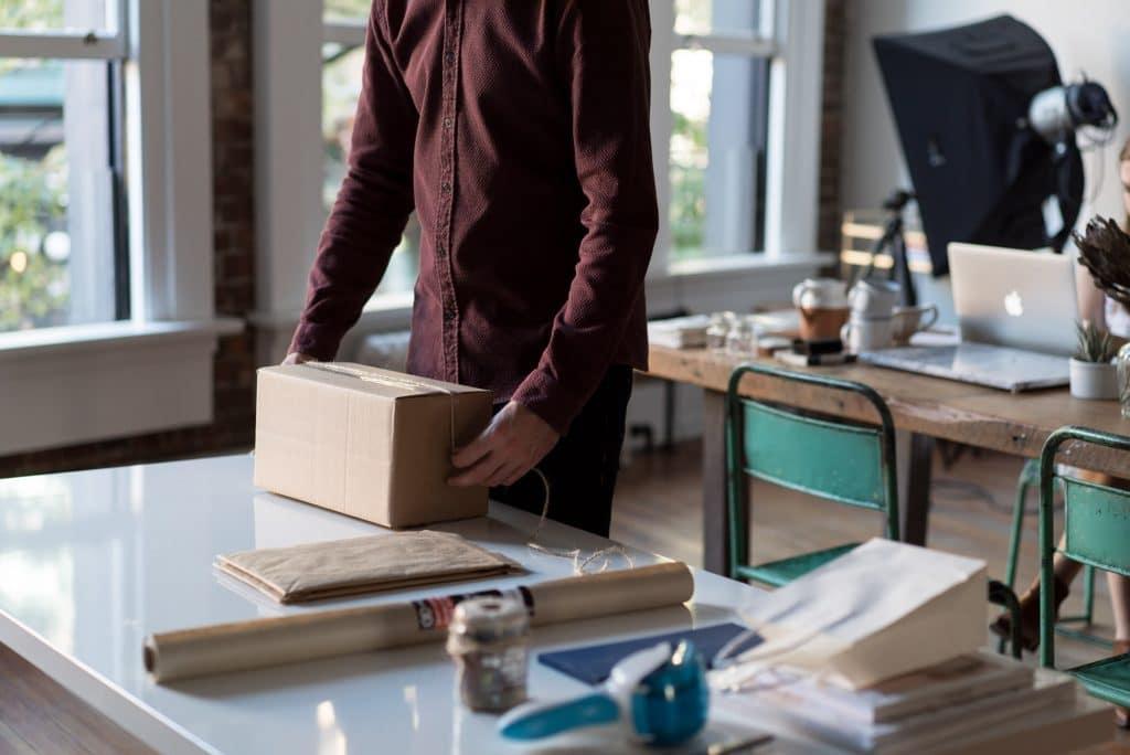 Man wrapping cardboard box